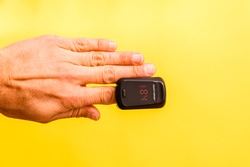 Oxygen saturation is measured with an oximeter, placed on the patient's finger.