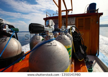 oxygen tanks and diving equipment on diving boat #1350141980
