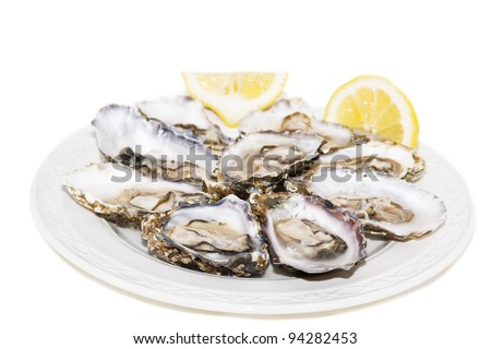 Oyster and lemon on white background On white plate