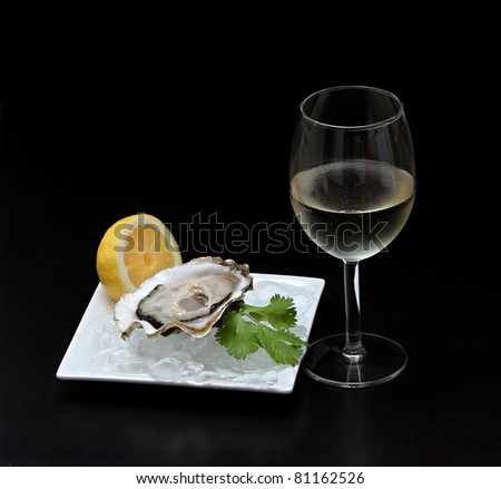oyster and wine on a black background