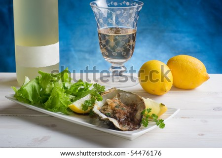oyster au gratin with salad on dish