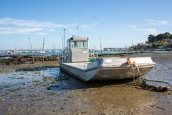 Oyster Farmer with Fishing Boats at Low Tide / Bassin Arcachon France Village of The Canon