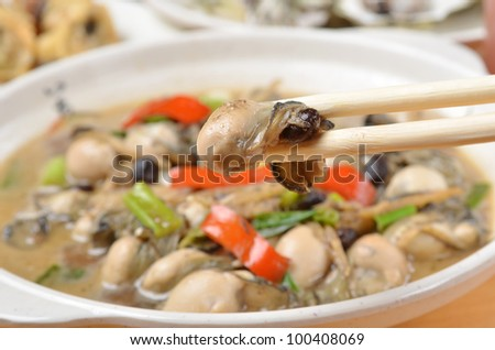 Oyster in black bean sauce   - A Popular Taiwan seafood                    prawn and chop sticks