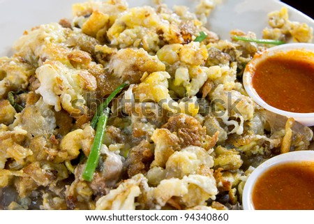 Oyster Omelette with Chili Sauce by Singapore Street Food Vendor