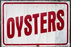 Oyster sign signage at local seafood market