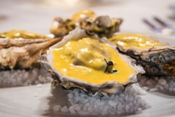 Oysters Rockefeller Broiled in Half Shall on a White Plate, a Typical Dish of New Orleans Cuisine