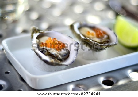 Oysters served with salmon roe