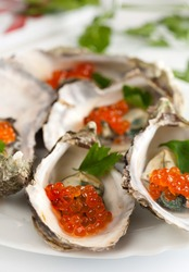 Oysters with red caviar