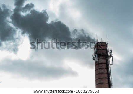 ozone depletion, chemical threat, pollution of nature and air.  old pipe of the boiler room. ejection into the air of smoke. #1063296653