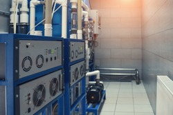 Ozone generator for ozonation of pure drinking water in water production factory, close up.