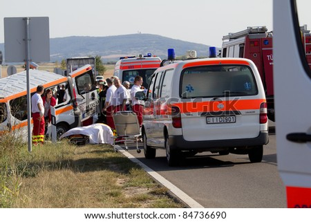 PÉCS, HUNGARY - SEP 15: Firefighters help the victim of car accident on Sept.15, 2011 on Road 6 in Pécs, Hungary.
