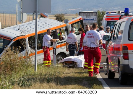 PÉCS, HUNGARY - SEP 15: Firefighters help the victim of car accident on Sept. 15, 2011 on Road 6 in Pécs, Hungary.