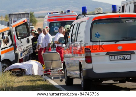 PÉCS, HUNGARY - SEPT. 15: Firefighters help the victim of car accident on Sept. 15, 2011 on Road 6 in Pécs, Hungary.