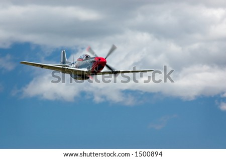 P-51 Mustang fighter with clouds