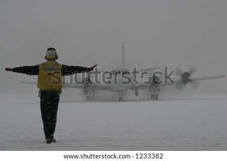 P-3 Orion Taxiing in Snow