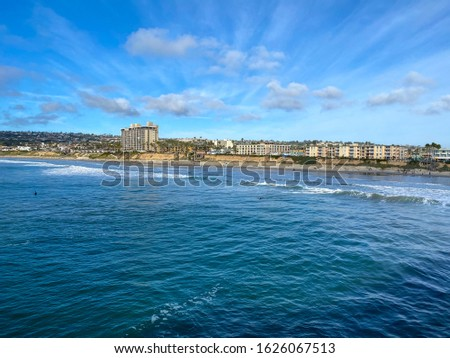 Pacific beach shoreline seen from the pier during sunny day, San Diego, Clifornia, USA