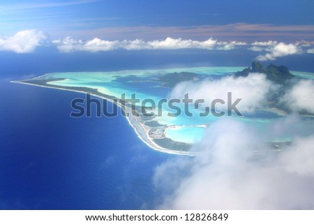 Pacific Island Bora Bora hidden by the clouds. Aerial view. French Polynesia