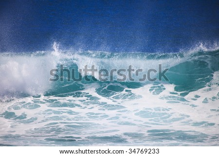 Pacific ocean wave crests and breaks at Point Panic, Honolulu, Hawaii