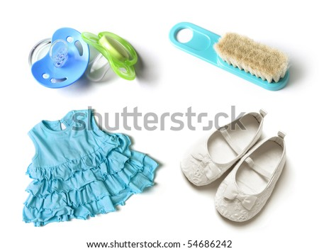 pacifiers, baby hairbrush, baby girl dress and baby shoes