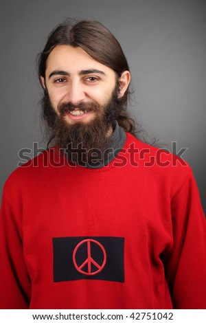 pacifist - peace and love, smiling man with black beard with symbol of peace on his sweater