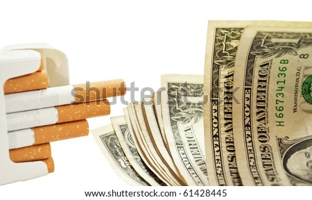 Pack of cigarettes and dollars - quit smoking concept -