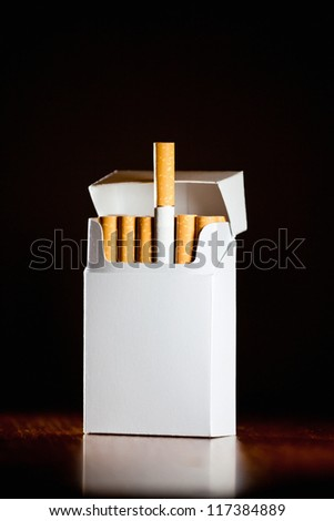 Pack of cigarettes isolated on black background,small depth of field