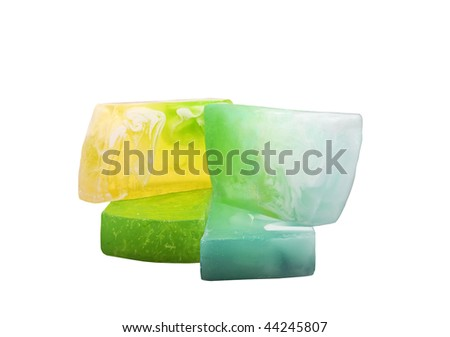 Pack of 4 colorful bars of handmade natural soap ( fresh grass, lemon, mint and oceanic flavor ) isolated on white background.