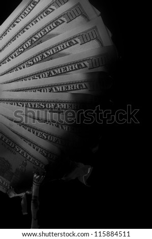 pack of dollars burned on black background