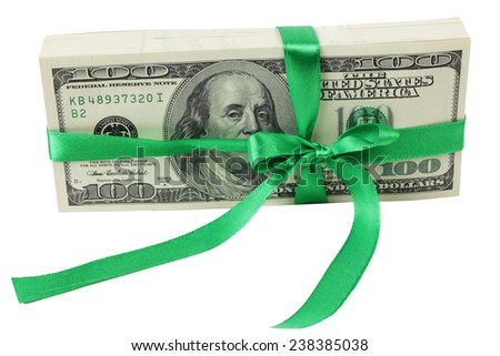 Pack of dollars in a green ribbon on white background on Holiday