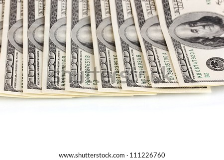 pack of dollars on white background close-up