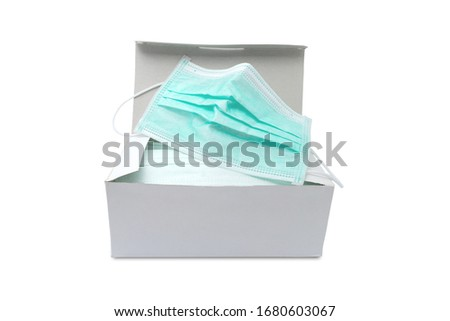 Pack of ear loop medical masks in box with medical mask on top isolated on white background with clipping path. anti virus and bacteria protective face air pollution,  protection concept.