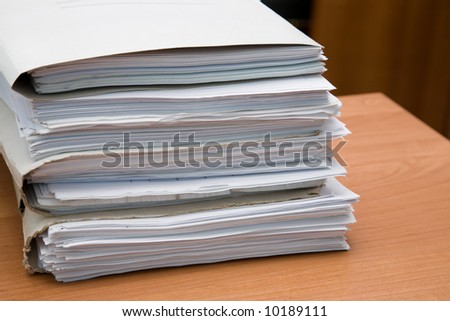 Pack of paper documents on a desk
