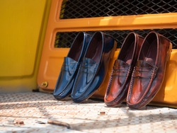 Pack shot of men fashion penny loafer shoes leather.