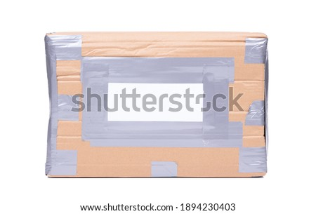 Package with black adress sticker, grey duct tape, isolated Photo stock ©
