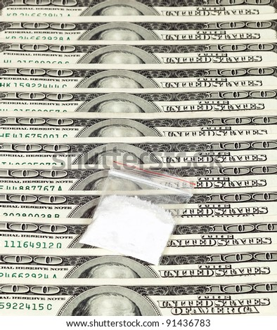 Package with drug over the U.S. dollars background - stock photo