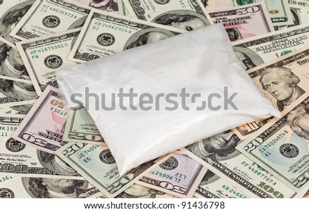 Package with drug over the U.S. dollars background