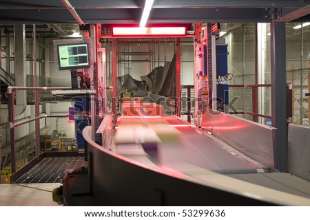 Packages being scanned and distributed on conveyor belt
