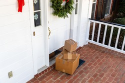 Packages on front porch of home during holiday season