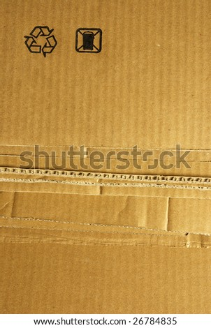 Packaging cardboard with a recycle symbol