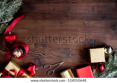 packaging christmas gifts in boxes on wooden background top view #524050648