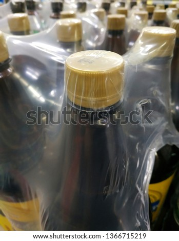 packaging of brown beer bottles with a yellow cap #1366715219