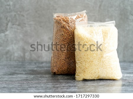 packaging of buckwheat rice lying on a gray background Stockfoto ©