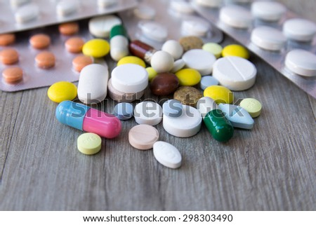 Packaging of tablets and pills on the table. Medicine