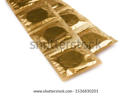 packaging with condoms isolated on a white background, the concept of protection against sexually transmitted diseases, unwanted pregnancy, sexual education in educational institutions #1536830201