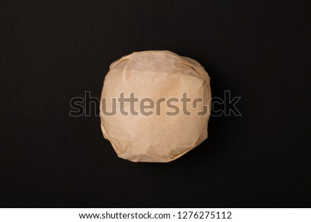 Packed burger on black background, top view. Wrapped hamburger sandwich, blank mock up Stock photo ©