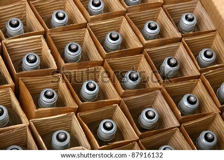 Packed rows of light bulbs in a cardboard box
