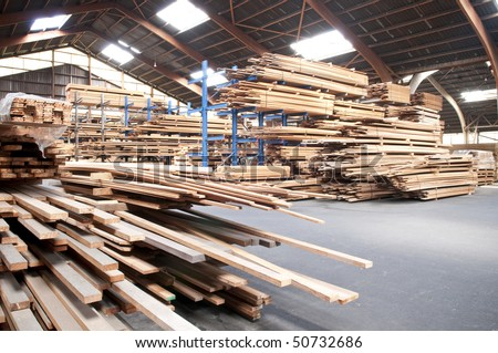 packed warehouse with wood ready for construction