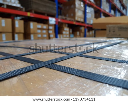 Packing accessories at workplace of industry,Polypropylene Strapping for semi-automatic strapping machines,Parcel with strapping,Shipping concept