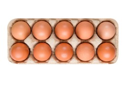 packing; box of brown; beige eggs isolated on white background; top view; 10 pieces