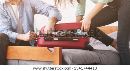 Packing suitcase. Couple trying to close valise, preparing for honeymoon, crop
